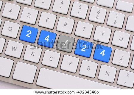 24/24 in blue on white keyboard