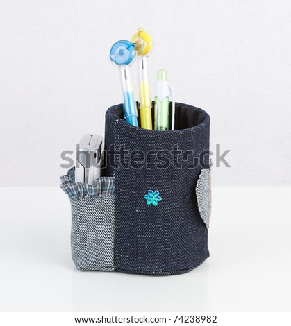 2 in 1 pencil box that has a socket to keep a mobile phone - stock photo