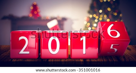 2016 in red blocks against christmas tree with presents near the fireplace - stock photo