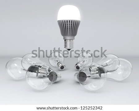 incandescent lamp was replaced by energy efficient LED lamp concept - stock photo