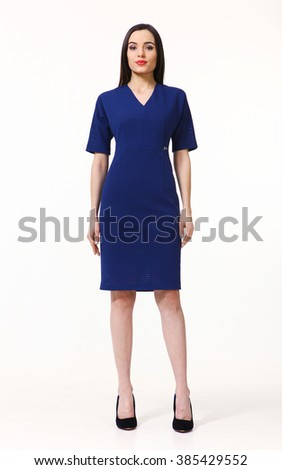 indian asian eastern brunette business executive woman with straight hair style in office blue dress high heels shoes full length body portrait standing isolated on white  - stock photo