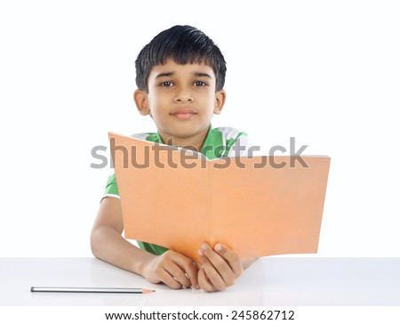 Indian School Boy Posing to Camera - stock photo