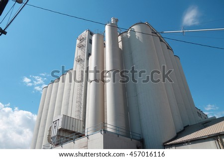 industrial silos with blue sky