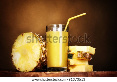?ineapple juice and pineapple on brown - stock photo