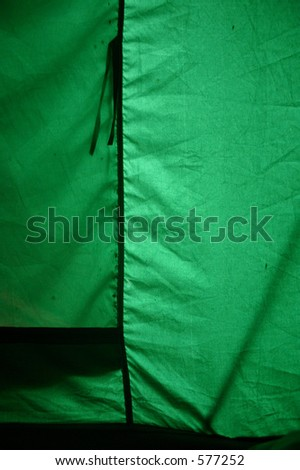 Inside of a tent flooded by light. Not retouched, good as background or texture. Intense color, try unsharp mask to bring out the various creases. - stock photo
