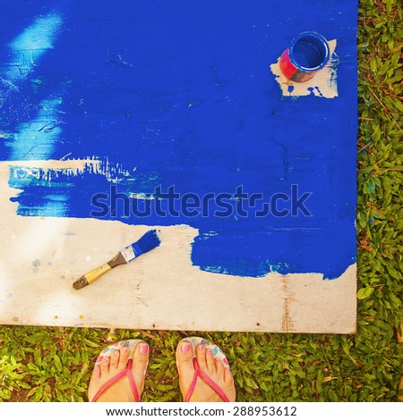 """""""instagram"""" style top view photo of unfinished painted wooden deck - stock photo"""
