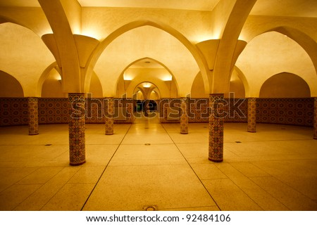 Interior arches and mosaic tile work of hammam turkish bath in Hassan II Mosque in Casablanca, Morocco. - stock photo