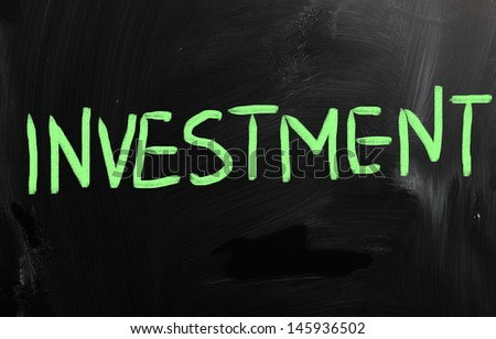 """Investment"" handwritten with white chalk on a blackboard"