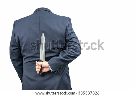 Invisible man in a suit holding a knife on a white background.
