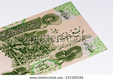 0.25 Iraqi dinar bank note. Iraqi dinar is the national currency of Iraq - stock photo