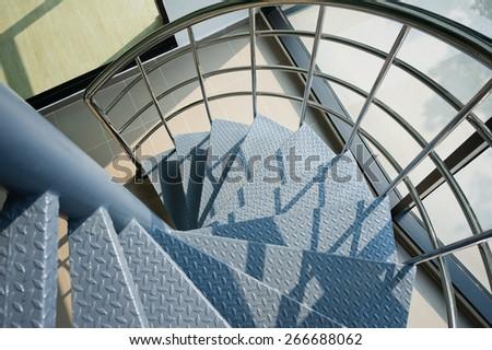 iron spiral stair - stock photo