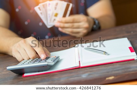 is opening bank account and checking credit card information  - stock photo
