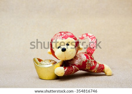 2016 is year of the monkey decorate with gold ingot for chinese new year
