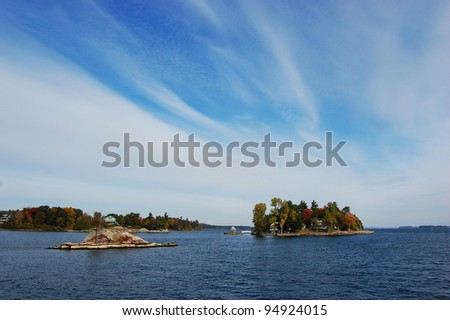 1000 islands region, Small Island in Thousand Islands Region in a sunny fall in New York State - stock photo