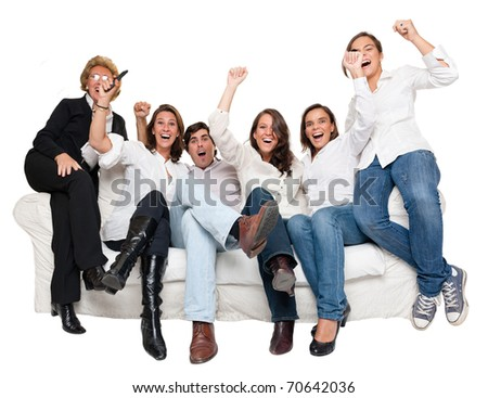 Isolated group of family members sitting at home cheering - stock photo
