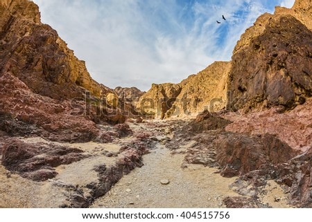 Israel in January. Multicolor and picturesque Black canyon in ancient mountains of Eilat