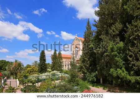 Israel.  The Trappist monastery - Latrun.  The magnificent building of the temple is surrounded by a lush garden - stock photo