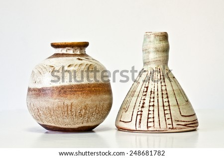 Israeli ceramic pair in brown tones: two vases of 1950-th years. Abstract pastel images. Symbolizes couple: He and She; brother and sister, bride and groom etc. Isolated on white.  - stock photo