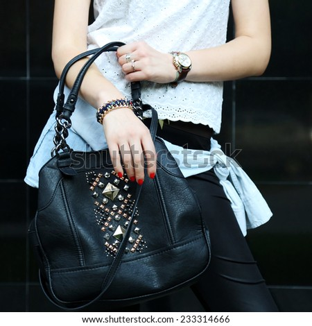 It's all about fashion, Young fashionable woman holding a leather handbag - stock photo