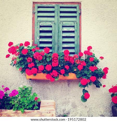 Italian Window  Decorated with Fresh Flowers, Retro Effect - stock photo