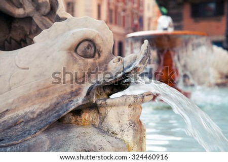 Italy, Rome, fragment of fountain with dolphin sculpture.Piazza Colonna, Via Del Corso - stock photo