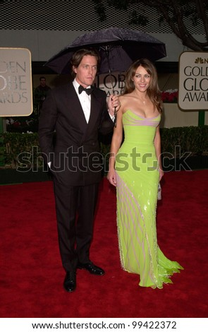 23JAN2000:  Actor HUGH GRANT & actress girlfriend ELIZABETH HURLEY at the Golden Globe Awards in Beverly Hills.  Paul Smith / Featureflash