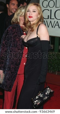 """19JAN97:  Actress/singer MADONNA at the Golden Globe Awards where she won Best Actress in a Musical or Comedy for """"Evita.""""        Please Credit: Pix: JEAN CUMMINGS - stock photo"""