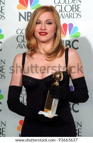 "19JAN97:  Actress/singer MADONNA at the Golden Globe Awards where she won Best Actress in a Musical or Comedy for ""Evita."" Please Credit: Pix: JEAN CUMMINGS - stock photo"