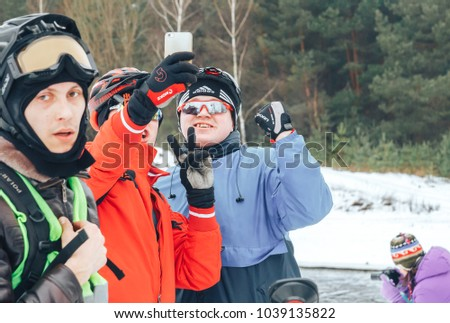27 JANUARY 2018, Minsk, Belarus: Winter minus 100 Cross-country and cross-country cycling competitions in winter Two men in bicycle helmets beside bicycles