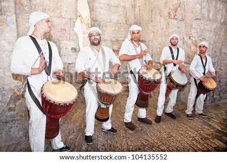 JERUSALEM, ISRAEL - APRIL 26: Israeli famous musicians at the Zion gate in the old part Jeruslalem on a jewish holiday Israel's 64th Independence Day on April 26, 2012 in Jerusalem, Israel - stock photo