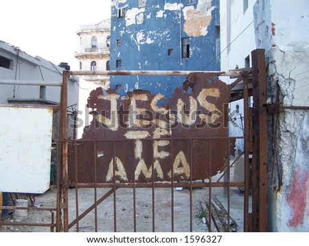 """Jesus loves you"" - writing on the entrance to a poor building of Havana city. Cuba - stock photo"