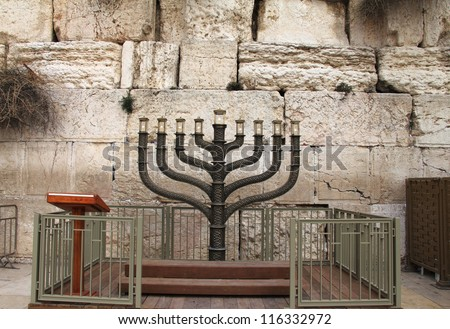 Jewish hanukkah candle-holder near Western wall, Jerusalem, Israel - stock photo