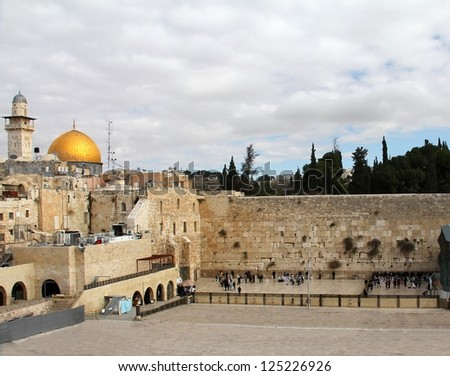 Jewish worshipers pray at the Wailing Wall an important jewish religious site. Jerusalem, Israel - stock photo