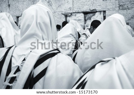 Jews pray at the Western Wall in Jerusalem. - stock photo