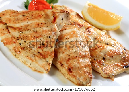 juicy grilled chicken fillet and lemon - stock photo