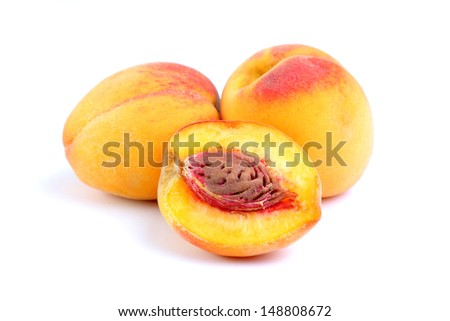 Juicy peaches on white