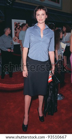 "07JUL99:  Actress CHARLIZE THERON at the world premiere of ""American Pie"" at Universal City, Hollywood.  Paul Smith / Featureflash - stock photo"