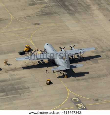 19 July 2016, Eindhoven Airport, Netherlands. Aerial view of Royal Dutch Air Force Lockheed C-130 Hercules military transport plane parked at Eindhoven Airbase in Holland.