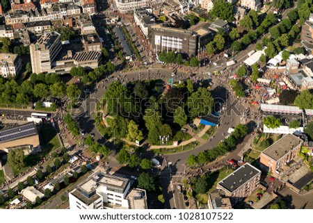 21 July 2017, Nijmegen, Holland. Aerial view of roundabout Keizer Karelplein during the finish of the Four Days Marches, the Vierdaagse. Lots of people on the street and big trees in the center.