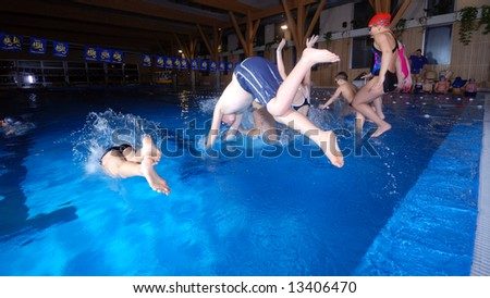.jumping in swimming pool - stock photo