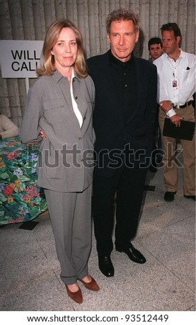 """08JUN98:  Actor HARRISON FORD & wife MELISSA MATHISON at premiere of his new movie, """"Six Days, Seven Nights"""" in which he stars with Anne Heche. - stock photo"""