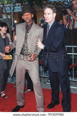 "28JUN99:  Actors WILL SMITH (left) and KEVIN KLINE at the world premiere of their new movie ""Wild Wild West"" in Los Angeles.  Paul Smith / Featureflash"
