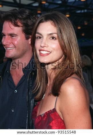 "17JUN98:  Supermodel CINDY CRAWFORD & new husband RANDY GERBER at premiere of George Clooney's new movie ""Out of Sight,"" at Universal Studios, Hollywood."