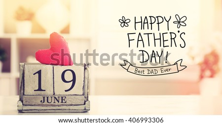 19 June Happy Fathers Day message with wooden block calendar  - stock photo