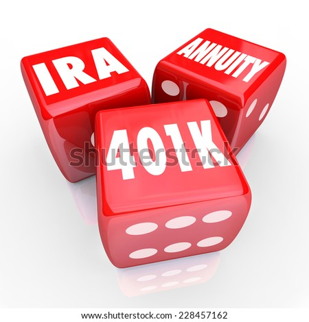 401K IRA and Annuity words on three red dice to illustrate risk and chance in savings for retirement with interest bearing accounts - stock photo