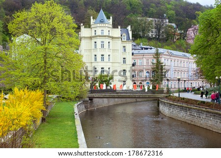 KARLOVY VARY, CZECH REPUBLIC - MAY 03, 2013: The quay of Tepla river in Karlovy Vary at the spring time - stock photo