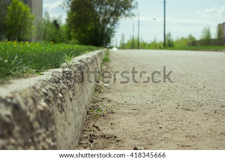 kerb line or curb stone border on the asphalt old town road  - stock photo