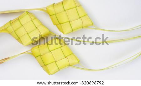 Ketupat (Rice Dumpling) On White Background.Traditional Malay Food During Eid Mubarak.Selective Focus.                               - stock photo