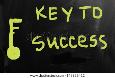 """Key to success"" handwritten with white chalk on a blackboard - stock photo"