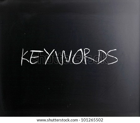 """Keywords"" handwritten with white chalk on a blackboard. - stock photo"